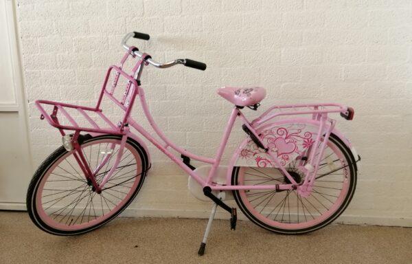 Roze fiets met rekje • 26.23